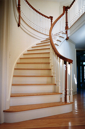 This Very Graceful Stair Has Red Oak Treads And Cherry Handrails.